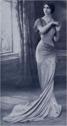 Parisian designer Jeanne Margaine-Lacroix's daring robe-sylphide gowns brought her great renown. The figure-revealing dresses caused a sensation in 1908 and launched the slender silhouette of the twentieth century.
