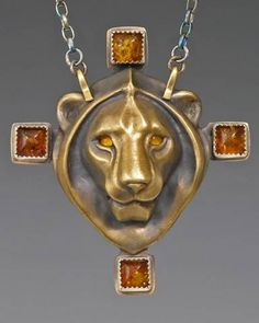Bronze LionHeart w/ Amber by Brooke Stone Jewelry Handdrafted Cast bronze, fabricated bronze, Baltic amber, silver, amber eyes.   lion head: 2 inch length; overall length: 2 3/4 inches