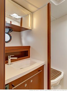 Beneteau Swift 44: The wet head has opening portlights, a pull-out shower nozzle, and a teak deck drain.