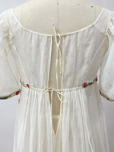 Circa 1805 muslin French empire waist gown embroidered with cotton, wool, and metallic thread. Detail.