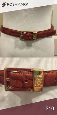 Genuine Leather Alligator Print Belt This belt is in excellent condition and is made of 100% leather. It is a brown alligator print with a gold buckle. Anne Klein Accessories Belts