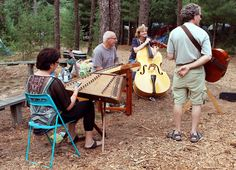 FOREST JAMMERS – Musicians partake in a jam session in the woods during the Wheatland Music Festival on Sept. 8 in Remus, Mich. It was the festival's 40th anniversary, which features primarily folk and bluegrass fare. Next year's is slated for Sept. 5-7. (Photo by LSSU Photojournalism Student Paul Burke)