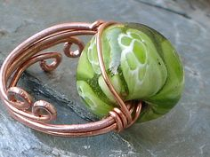 bead ring wire wrapped project tutorial. Lots of other free tutorials on the site. love it! must try! #ecrafty