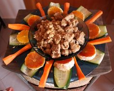 Pork bites with milk, soja sauce and almonds accompanied with vegetables and oranges