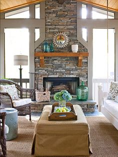 A fireplace makes this screened-in porch livable no matter what the season. The cultured stone veneer on the fireplace is a light alternative stone, with all the aesthetic properties of the actual stone. Variegated tones and textures match the room's neutral color palette and add dimension to the room. Soaring from floor to ceiling, the fireplace accentuates the room's height.