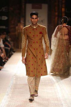 Mustard color Indian groom men's sherwani by Anju Modi at Lakme Fashion Week Winter 2014. More here: http://www.indianweddingsite.com/lakme-fashion-week-winter-2014-anju-modi-collection/