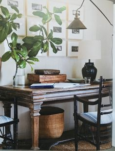Antique desk and botanical prints.