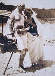 "In a photo taken on the beach at La Garoupe in 1926 Gerald poses with Sara in distinctive Riviera style: a striped jersey, espadrilles, and knitted fisherman's cap. ""They have to like it,"" said one of Fitzgerald's characters about the Murphy's fictional counterparts, ""they invented it."" The Murphy's were inspiration for ""Nicole and Dick Diver"" in Tender is the Night."