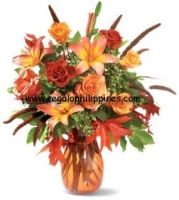 � An orange glass teardrop vase, filled with orange Asiatic lilies, bi-color peach roses, orange roses, brick-colored roses, accented with salal, oregonia and autumn leaves.   You can send your inquiry:  Email us: info@regaloph.com Contact us: +63-02-413-3333 Website: Regaloph http://regaloph.com Facebook: Regaloph.com fan page