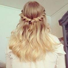 This waterfall braid is perfect for wedding hair inspiration. It is a good half-up hairstyle for bridesmaids or a bridal hair look with a veil.