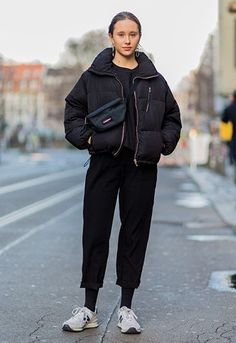Street style girl wearing puffer jacket, bum bag and a pair of New Balance trainers | ASOS Fashion & Beauty Feed