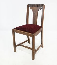 The Turner oak dining chair has an upholstered seat that seats off the great details of the elegant and unusual back.