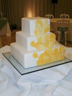 wedding cakes, square cakes, white and yellow cakes, specialty cakes, 3 tier cakes, http://tiered-expressions.com