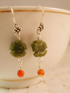 I have paired delicate carved flower jade beads with soft carnelian drops to create these earrings. Completing the design, I used decorative earwires from Bali, Indonesia. Enjoy your petite flowers!  https://www.etsy.com/listing/50504081/green-jade-flowers-carnelian-drops-and?