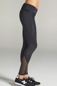 Sleek fashion forward legging with mesh insets at hip and calves. Comfortable second skin like fabric. Mid-rise, figure contouring waistband.