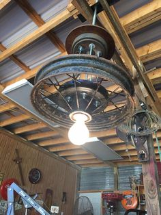 vintage wheel converted to an overhead light fixture.