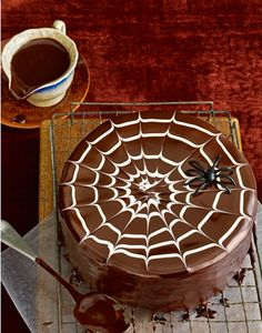 Halloween cake, very simple but very effective! Love the spiders web of white chocolate. YUM...