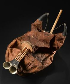 Zukra - bagpipes consisting of a goatskin bag set with reed pipes and chanter: Tunisia, Tunis, 19th century