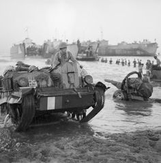 A British Universal Carrier Mk I comes ashore with troops and guns during the invasion of Sicily on 10 July 1943.