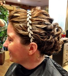 Bridal curled updo with a beautiful headband