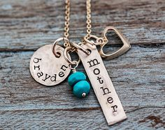 Mommy Necklace. Multicharm necklace in sterling silver with a bit of turquoise and a rustic look. #necklace #mothersday Mother's Day Jewelry