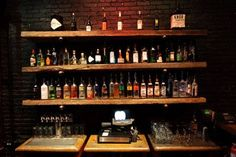 Simple Back Bar Liquor Display With Exposed Brick