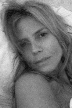 Heidi Klum lounging in bed Sept. 17, 2014.   - MarieClaire.com