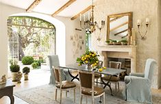 A Magical Ojai Oasis Though they did manage a small flock of chickens in their charming Santa Monica home, their menagerie has now expanded to include dogs, miniature donkeys, goats, and a rabbit. They also have three children, two of whom have left the nest. Dining table by BoBo Intriguing Objects; leather chairs and chandelier, Lucca Antiques; armchairs in Rogers & Goffigon linen, Giannetti Home; sconces, Aidan Gray; rug, Jamal's Rug Collection.