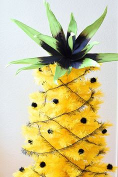 How to decorate a yellow tree to look like a pineapple.