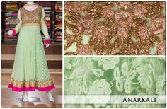 Look glamorous yet classy in this green anarkali suit engraved with rich zari embroidery work in the yoke. The pink and golden border makes a lovely color combination.