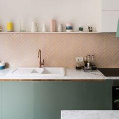 Calcutta marble backsplash and custom oak cabinets
