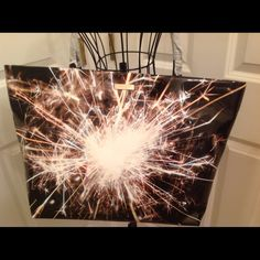 Kate Spade Let Sparks Fly Small Coal Tote NWT This is a great tote from Kate Spade!  NWT.  The style is Let Sparks Fly Small Coal.  Open top.  Polyurethane shell with PVC trim. kate spade Bags Totes