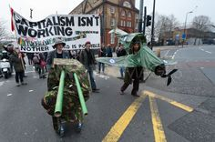 A protester dressed as a spitfire at Camberwell Green from where they marched to Kennington to join the South London feeder to the TUC March for the Alternative South London, Alternative, Join, March, Mac, Mars