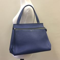 Blue Celine Edge Bag Authentic Celine in excellent condition! Small tear on the zipper lining (photoed) and small tear where the zipper meets the bag (photoed) please ask question, no trade or PP! Celine Bags