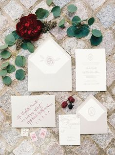 Invitation shot - flat lay of all cards/envelopes with some floral decor