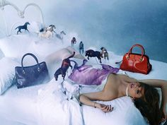 David LaChapelle shot a dreamlike campaign for Tod's Sella bag. The campaign features model Anais Pouliot and some toy horses. David Lachapelle, It Bag, Vogue Paris, Horse Photography, Fashion Photography, Tods Bag, Louis Vuitton Dress, Bags 2014, Horse Fashion