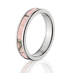This AP Pink Realtree Ring with inlaid Authentic Camo is a sure hit for the woman who loves the outdoors. It is a great way to show your love for the outdoors as well as your spouse.. This AP Pink Camo ring is a very popular choice for hunters and fashion lovers alike. It matches everything! You are going to love it!  http://www.thejewelrysource.net/index.php/outdoor-lovers/realtree-camouflage-rings/licensed-realtree-ap-pink-camo-ring-cobalt-chrome.html