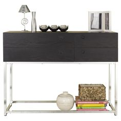 Found it at AllModern - Shield Console Table in Blackhttp://www.allmodern.com/deals-and-design-ideas/p/Side-Show%3A-Dining-Room-Storage-Shield-Console-Table-in-Black~XHX1899~E13284.html?refid=SBP.rBAZEVPvxOQwvG1dnXE4AhFbzVLSpUvOpry3u7w7pO8