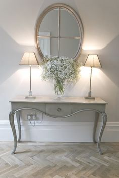 Might you want a table in the hallway? Or would you rather keep it clear? Hall console table with mirror and pair of lamps. If you like this, come on over and join us at www.FlorenceAndFreya.com. Join up for a whole home decorating resource library.