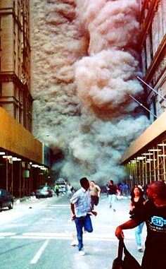 This is a picture of 9 11 when the building was collapsing. You can see people scared out of there mind and running.The expression on the peoples face are unbelievable,you can tell that no one was expecting the accident to happen.
