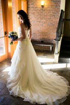 Sheer, feminine fabrics are perfectly set off by the modern, urban brick at The Foundry at Oswego Pointe wedding venue near Portland, OR.
