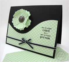 handmade card ... two colors: black and pale green ... dramatic contrast!! ... luv the French curve and how the  layered flower sits perfectly into into it ... reminds me of the yin yang symbol ... great card!! ... Stampin' Up!