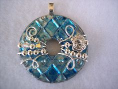Beautiful Unique Blue Wire Wrapped Washer Pendant and Chain. $23.00, via Etsy.