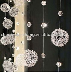 Crystal clear Tear Drop Beads- I am not to sure where you would be able to buy these commercially but I love them and would be perfect for dangling off my central internal cross to mimic the idea of rain water falling. Found on:http://bolgcurtains.com/crystal-beaded-curtains/