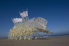"""Strandbeest by Theo Jansen. Jansen says: """"The walls between art and engineering exist only in our minds."""" In 1990, he began to build large mechanisms out of PVC that are able to move on their own. He strives to equip his creations with their own artificial intelligence so they can avoid obstacles by changing course when one is detected, such as the sea itself."""