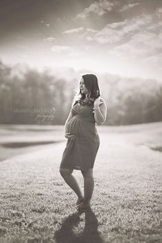 Black and white full body maternity shot. Pregnancy poses and pictures in summer. Maternity poses in dress. Spring flowers pregnancy pictures. Maternity Super cute and unique pregnancy pictures taken outside. Spring outdoor session. Pregnancy photo shoot ideas with father husband or dad. Unique pregnancy poses and photo sessions. Lauren Davidson Photography.