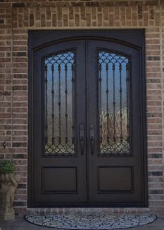 Upgrade your entryway with this ornate wrought iron door from Clark Hall. Designed with a twist on tradition, this front entry door is timeless. Front Door Design Wood, Grill Door Design, Double Door Design, Main Door Design, Hall Design, Custom Exterior Doors, Double Doors Exterior, Exterior Windows, Double Front Entry Doors