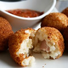 Arancini balls1 Recipe Basic Risotto Parmesan Left To Cool For At Least 4 Hours 2 oz. Mozzarella Cheese Cut Into 1/2 Inch Dice 1 Piece Cooked Ham, Cut Into 1/2 Inch Dice 2 Cups Seasoned Bread Crumbs Oil For Frying