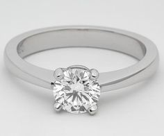This beautiful solitaire engagement ring has a platinum band thats thin, but not too thin, and tapered in slightly at the top as it nears the diamond. A wire basket makes the center diamond stand out and turns this setting from a ring into a statement! This ring can be set with a round, princess, cushion, Asscher, or carre cut diamond.