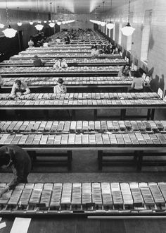 Men and women looking through the card catalogues at the Library of Congress, 1941.